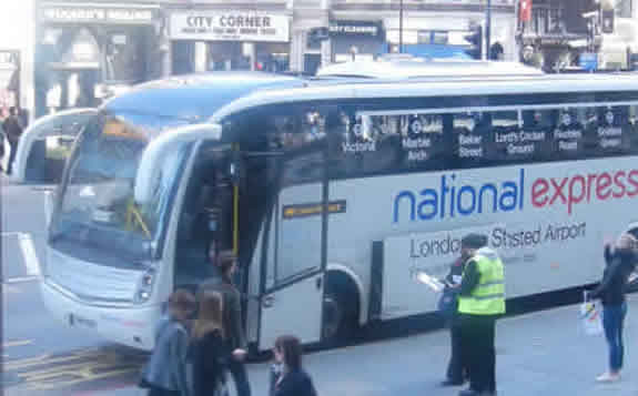 Stansted Airport Coach Of National Express Boarding At Liverpool Street